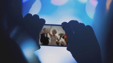 Filming wedding on phone.jpg